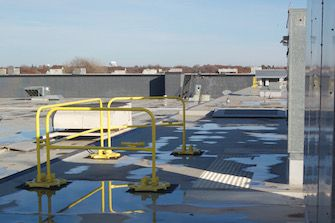A portable fall protection system used to protect only a single roof access point.